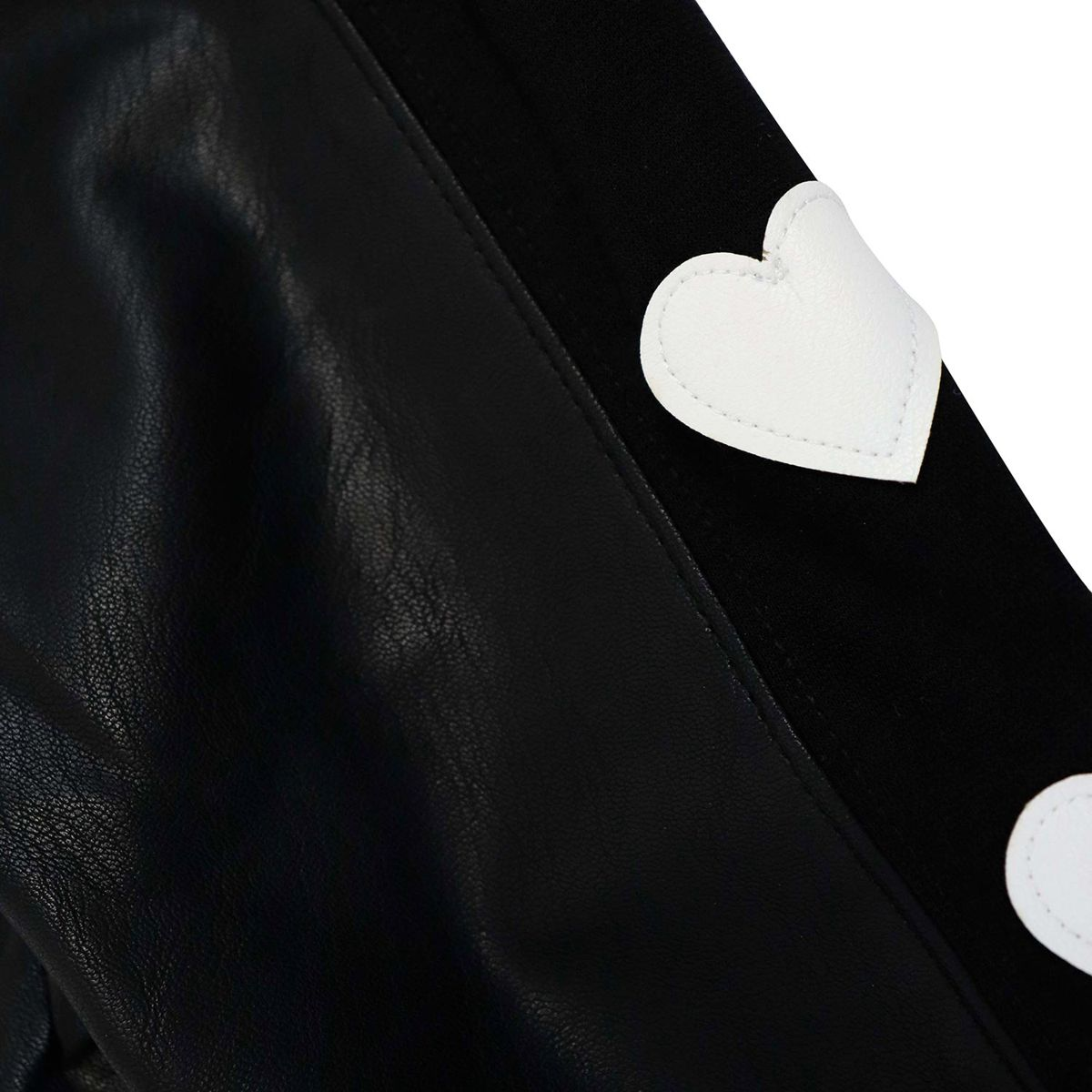 Faux leather leggings with a side knit stripe in hearts Black Monnalisa